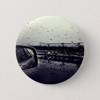 Peeking outside window after rain 2 inch round button