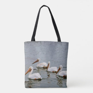 Pelicans looking for food tote bag