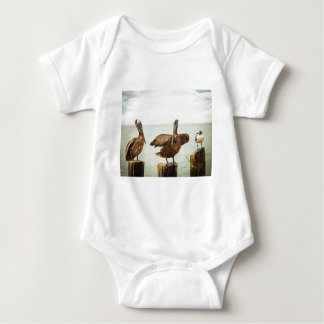 Pelicans perched on posts baby bodysuit