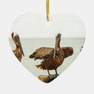 Pelicans perched on posts ceramic ornament