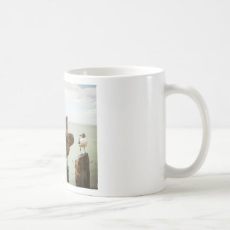 Pelicans perched on posts coffee mug