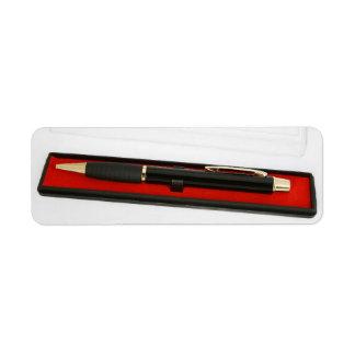 Pen in encasement return address label