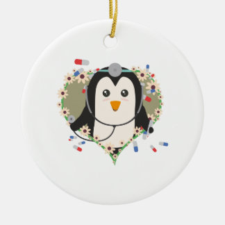 Penguin doctor with flower heart Zuq99 Round Ceramic Ornament