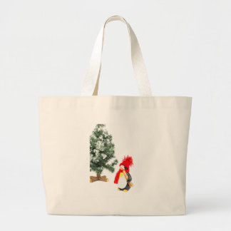 Penguin figurine with skis and christmas tree large tote bag