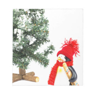 Penguin figurine with skis and christmas tree notepad