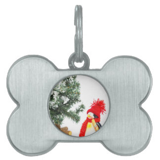 Penguin figurine with skis and christmas tree pet tag