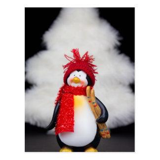 Penguin figurine with white christmas tree postcard
