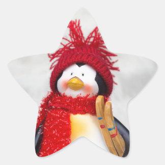 Penguin figurine with white christmas tree star sticker