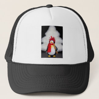 Penguin figurine with white christmas tree trucker hat