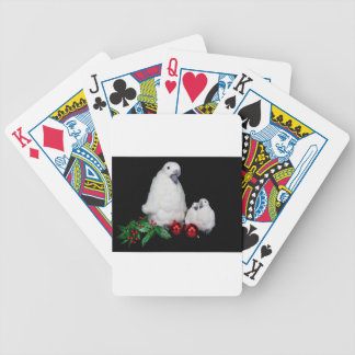 Penguin figurines as family with christmas balls poker deck