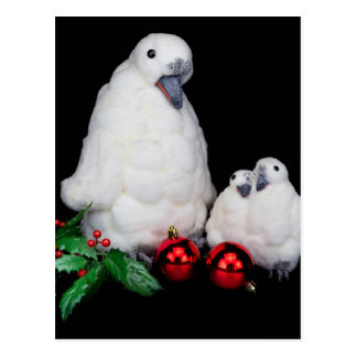 Penguin figurines as family with christmas balls postcard