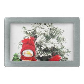 penguin figurines with christmas tree in winter belt buckles