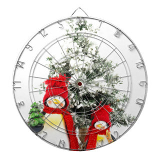 penguin figurines with christmas tree in winter dartboard