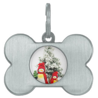 penguin figurines with christmas tree in winter pet tag