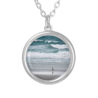 Penguin returning from the ocean silver plated necklace