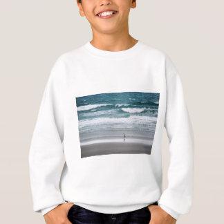 Penguin returning from the ocean sweatshirt