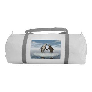 Penguins couple gym bag