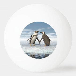 Penguins couple ping pong ball