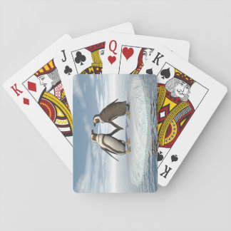Penguins couple playing cards