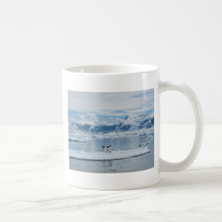 Penguins on an iceberg coffee mug