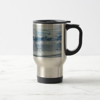 Penguins on an iceberg travel mug