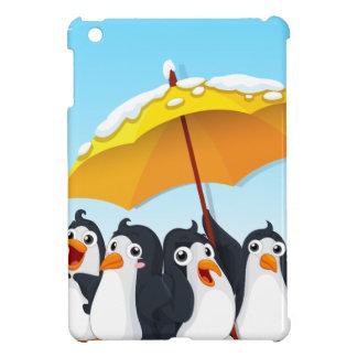 Penguins standing under umbrella case for the iPad mini