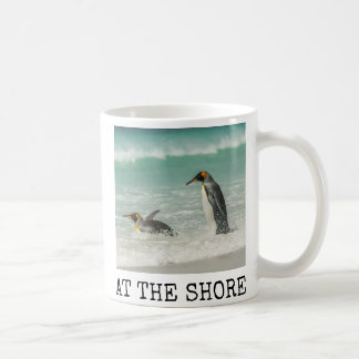 Penguins swimming on the beach coffee mug