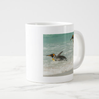 Penguins swimming on the beach giant coffee mug