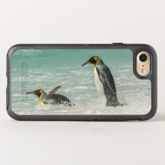 Penguins swimming on the beach OtterBox symmetry iPhone 7 case