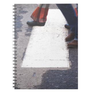people crossing notebook