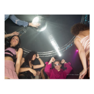 People dancing in a club postcard