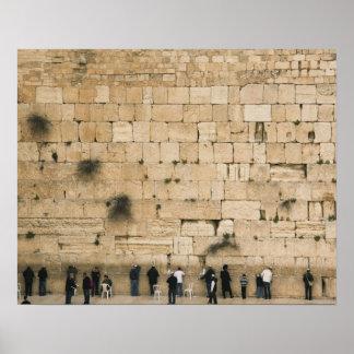People praying at the wailing wall poster