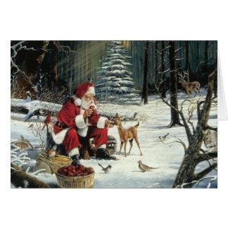 Père Noël alimentant la carte de Noël de faune