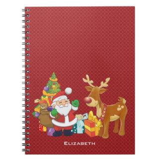 Père Noël et renne par l'arbre de Noël avec des Carnet