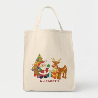 Père Noël et renne par l'arbre de Noël avec des Sac En Toile Épicerie