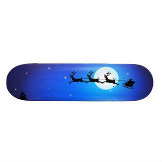 Père Noël et vol de renne à travers le ciel noctur Skateboard 21,6 Cm
