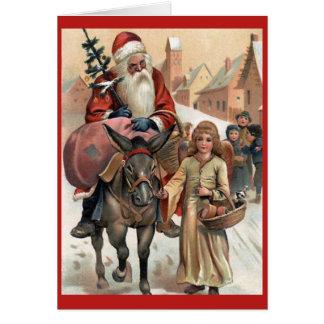 Père Noël sur la carte de Noël vintage d'âne