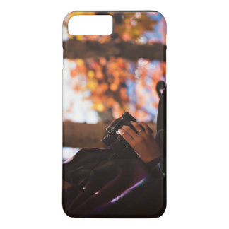 Person holding binoculars outside iPhone 7 plus case