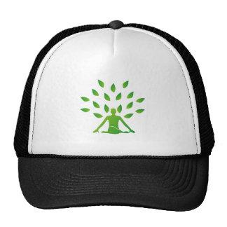 Person meditating under a tree trucker hat
