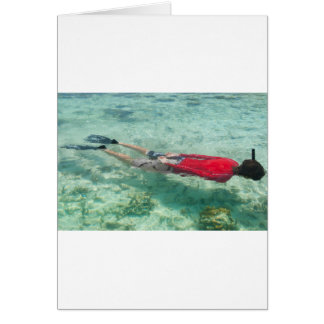 Person snorkeling in clear water card