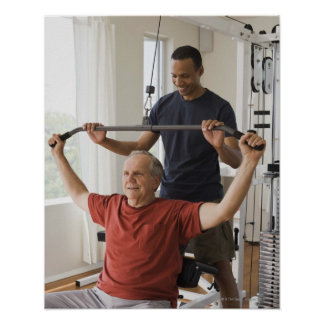 Personal trainer with man in home gym poster
