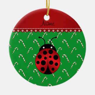 Personalized name ladybug green candy canes round ceramic ornament