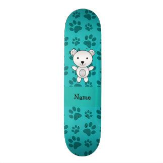 Personalized name polar bear turquoise paw pattern skateboard decks