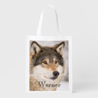 Personalized wolf face in a winter forest reusable grocery bag