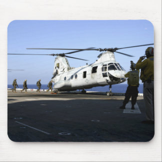 Personnel walk into the rear of a CH-46E Mousepads