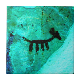 petroglyph on green tile