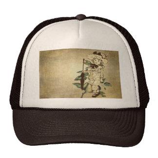 Peu de garçon vintage en tenue vintage avec des po casquette