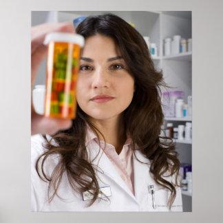 Pharmacist holding a pill bottle poster