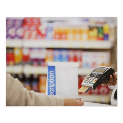 Pharmacist holding security device for customer posters