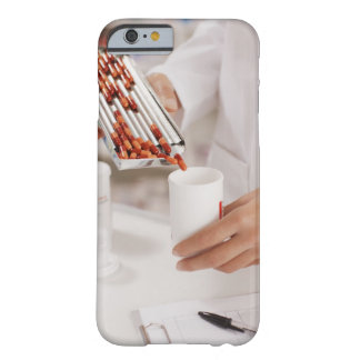 Pharmacist in drug store measuring pills into barely there iPhone 6 case
